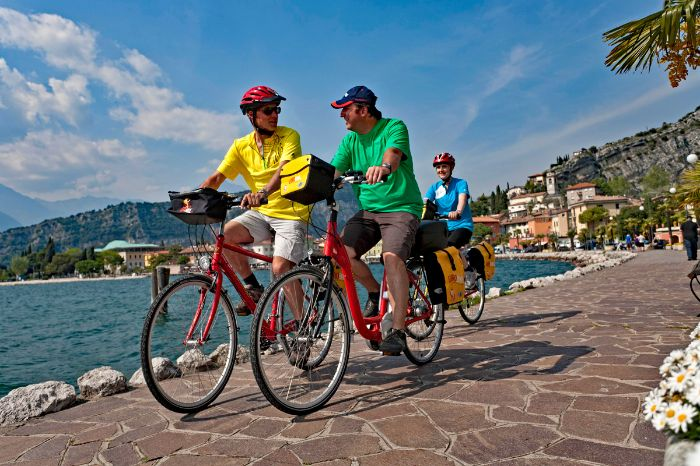 Cyclists at the lakefront of Lake Garda